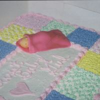Fondant Baby On Quilt Cake This is a close-up (kinda) of a sleeping baby made of fondant I put on top of a baby quilt cake I did for a baby shower. This was my first...
