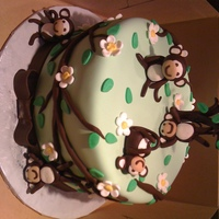 "Silly Monkeys   10"" round covered in fondant and designed to match invitations. Chocolate fondant monkeys and accents."