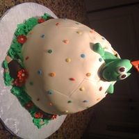 "Baby Dinosaur Hatching Egg cake made with Wonder mold and a 9"" round covered in fondant. The dinosaur is fondant and was inspired by some 3D figures here on..."