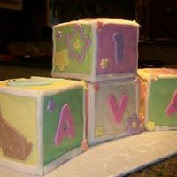 "Ava's 1St Birthday Blocks   Four 5"" block cakes covered in fondant with fondant cutouts."