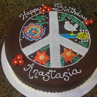 Peace Sign  40th Birthday cake. Client wanted the Woodstock bird, non-traditional flowers and peace sign. The flowers came from a pattern in Colette...
