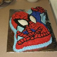Spiderman Cake Chocolate cake with buttercream icing. I used the Wilton Spiderman pan.