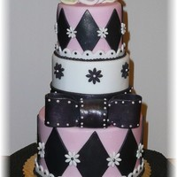 Pink, Black & White Cake This a cake dummy covered in fondant with fondant accents....my husband says it looks like leather and lace, lol. I don't see it but,...
