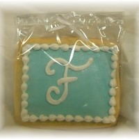 Monogram Cookie ~ Fondant I made 150 of these for a wedding, blue is fondant and white it piped RI.