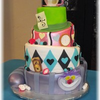 Madd Hatter/ Whimsical Chesire Cat Cake All airbrushed fondant using SPS and all accents done in either gumpaste or fondant.
