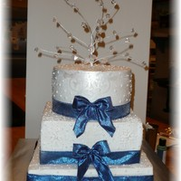 Snowflake Cake Buttercream cake with piped snowflakes (except for a few that I cut using cricut, applied and then decided I didn't like!). The ribbon...