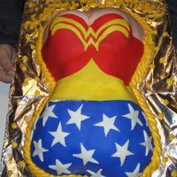 Diane's 40Th B-Day Wonder Woman Cake 1st attempt at sculpting a cake and 1st attempt at covering with fondant. Buttercream border. Lemon cake with raspberry filling. Actually a...