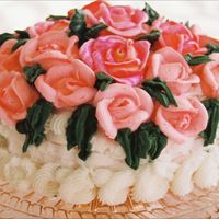 A Basket Of Pink Roses White basket of Pink Roses for Mother. White basketweave cake topped with pink royal icing roses with green leaves
