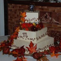 Whitney & Michael's Fall Wedding Cake Bottom tier was a fake tier to present a large centerpiece for a small wedding. The couple wanted a fall theme. I really am not very good...
