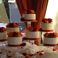 "Crystal Splendor Stand This bride and groom had a fixation with the number 7. So we did 7 7"" cakes with 7 roses on top of each one. More work than I expected..."