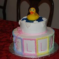 "Ella's Baby Shower Cake This was a fun cake! Used the wilton cake divider to make 10 blocks around the lower level. ELLA was in the ""front"" four blocks..."