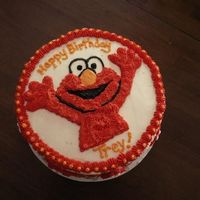 Elmo!   Yellow cake w/buttercream - store bought candy Elmos on side
