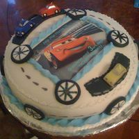 Mcqeen Race Car For A 3Yrs Old Boy   chocolate cake covered with rolled fondant.