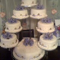 8 Tier Cakes   rich fruit cakes covered with rolled fondant and handmade flowers.