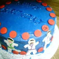 Daughter's Birthday Cake  Blue buttercream icing with fondant accents...the figures are karate people with different color belts some have black some yellow some...