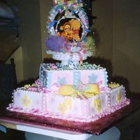 Lisy's Baby Shower 2 tier fondant bow and cut out flowers on buttercream