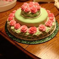 Green Cake W/ White Fondant Trellis And Pink Roses Light green fondant with white fondant trellis, royal icing pink roses... I made this for my 21st birthday :)