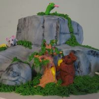 Animals At The Cliff This cake is made to resemble a section of cliff. It has a snake curled up in the sun on top. A mouse enjoying some cheese to the left. The...