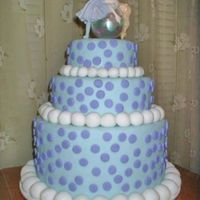 Tiered Bubble Fairy Cake This is a fondant cake with an Amy Brown Bubble Fairy Topper. The picture doesn't show it very well, but the polka dots match the...