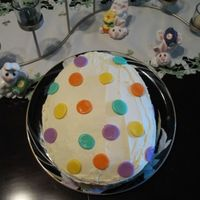 Eater Egg Cake Cake is french vanilla with vanilla pudding, frosted with buttercream and decorated with MMF circles (homemade MMF).