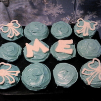 M-E's 17Th Birthday Tiffany Cupcakes  My niece asked me to decorate a cake or cupcakes in the colors of the famous Tiffany gift box so I made these cupcakes. Half are Devils...