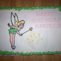 "Tinkerbell Birthday Cake 11"" X 15"" Chocolate sheet cake, buttercream frosting. Tinkerbell is a frozen buttercream transfer. (FBCT)"