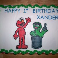 "Elmo And Oscar Birthday Cake 9"" X 13"" Yellow sheet cake with chocolate buttercream between layers, frosted with buttercream. Elmo and Oscar (my nephew's..."