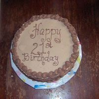 Jim's 21St B'day Cake   Devil's food cake with chocolate buttercream icing, chocolate mousse filling and decorations.