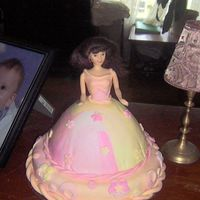 Emily's Doll Cake  This cake was made for my daughter's 6th birthday. Chocolate cake with buttercream icing, covered in MMF that was marbled pink, yellow...