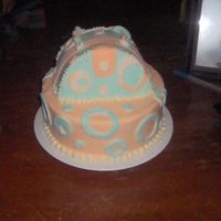 First Attempt At Purse Cake  This was my first try at a purse. I wasn't crazy about the colors, but my niece wanted orange and blue, so this is what I gave her....