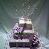 Lilac Parcel Cake a stacked parcel cake with a handmade crystal and lilac topper