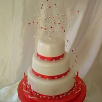 Red Crystal Cake a stacked 3 tier chococlate cake with a handmade crystal topper..all sprayed with pearl lustre and glitter