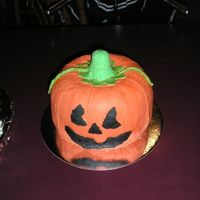 Pumpkin Cake Made for Halloween last year. Chocolate cake covered in BC.