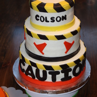 Construction Cake   !0, 8, 6 in round. Iced in buttercream with fondant accents.