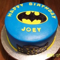 Batman 8 inch round. Iced in butter cream with fondant accents.