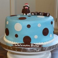 Sock Monkey Baby Shower   8 in. round cake iced in buttercream with fondant accents. Blocks and monkey made from fondant.