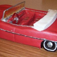 1962 Red Pontiac Bonneville Convertible White cake covered in fondant with fondant accents.