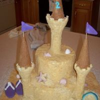 Sand Castle This is a 1/2 choc and 1/2 white cake w/BC. Covered in nilla wafers for sand affect. Chocolate shells, fondant accessories. Used part of...