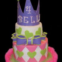 Bella's 4Th Cake covered in sugar sparkles, fondant accents, crown of gumpaste.