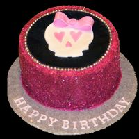 Girly Skull Vanilla cake, chocolate buttercream, covered in sugar sparkles with a fondant plaque