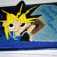 Yu-Gi-Oh I printed this picture off of the internet and traced it on the cake.