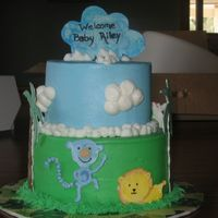 Jungle Shower Cake Buttercream frosting with RI jungle animals, gumpaste 'cloud' on top... still not sure why the cloud is blue... inspired by...
