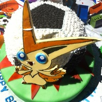 Soccer Ball With Pokemon Was a soccer ball cake , exploding from the grass . The pokemon is victini from pokemon black and white. cake was a butter cake and the...