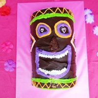 Smooshed Nose Tiki Cake Made this for my cousin-to-be's tropical themed bridal shower. I thought the cake would fit in the box, but when I got to the venue...