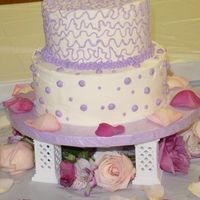 "Shirley's Bridal Shower Cake This is a two tier marble cake. The first tier is an 8"" round and the second tier is a 6"" round. The cake is frosted with..."
