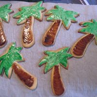 Palm Tree Cookies One of the designs I made for a large cookie order. Fondant covered NFSC, and painted the color onto the fondant