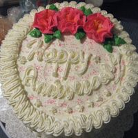 "Anniversary Cake 8"" vanilla WASC cake, cannoli filling, buttercream icing & decorations."