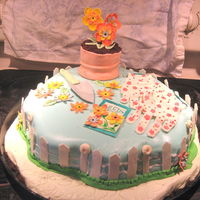 60Th Birthday Garden Cake Always wanted to do this from the Wilton book and an opportunity came up. Not as pretty and neat as in the book (fondant not happy with...