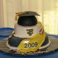 Graduation Cake  I made this for my Nephew...The cap is made from rice crispie treats covered in black fondant. The mortarboard is made from gumpaste, as...