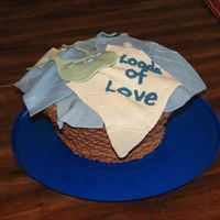 "Loads Of Love  Laundry basket with fondant baby ""clothes"". This cake turned out to be my 1st true disaster. It slid apart as I turned into the..."